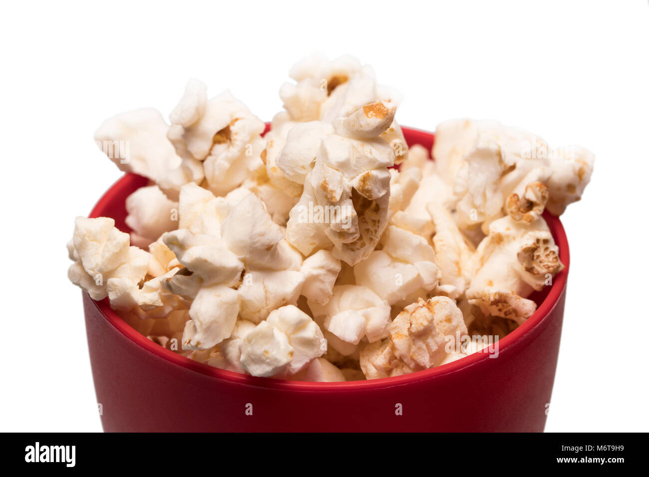 popcorn in a red bowl top view. Stock Photo