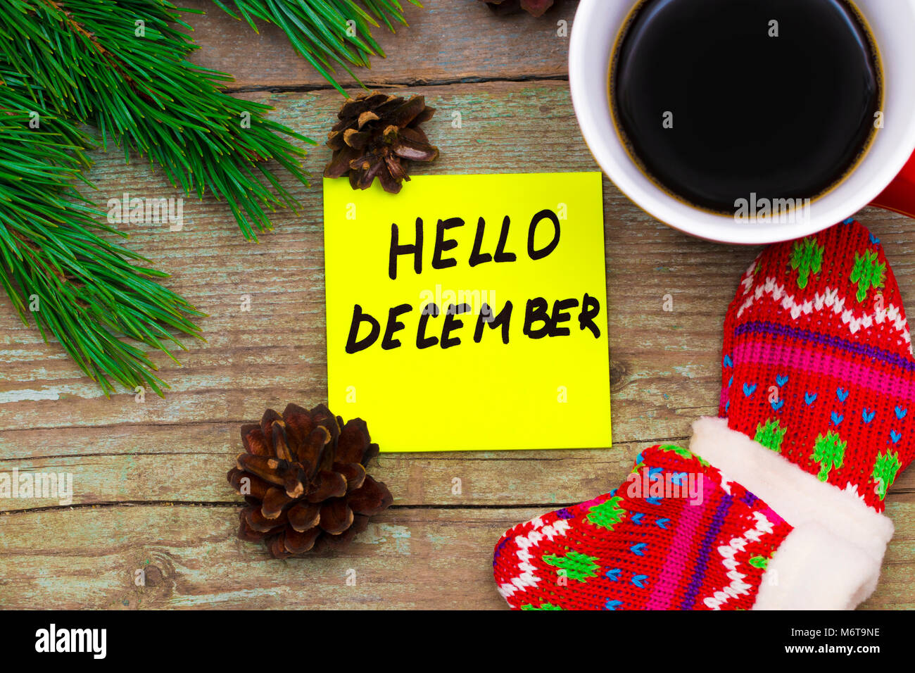 Hello December  Handwriting In Black Ink On A Sticky Note With A Cup Of  Coffee