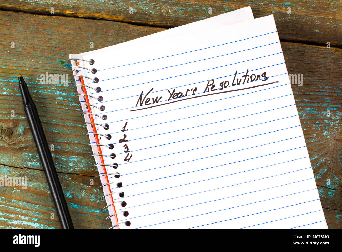 New Year's Resolution written on a notepad and pen  New Year Stock