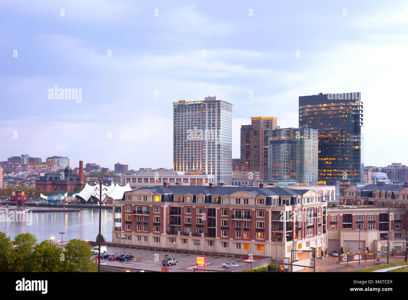 Baltimore, Maryland, United States - Condo and office and apartment buildings on Baltimore Inner Harbor. - Stock Image