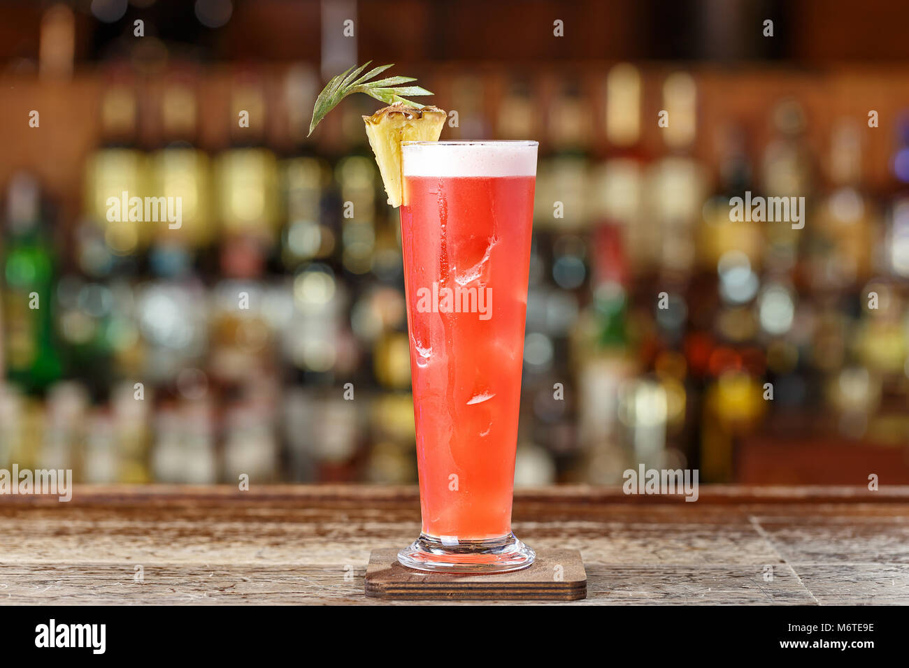 Alcoholic cocktail on the basis of gin, cherry, orange and liqueur 'Benediktin', grenadine, pineapple and - Stock Image