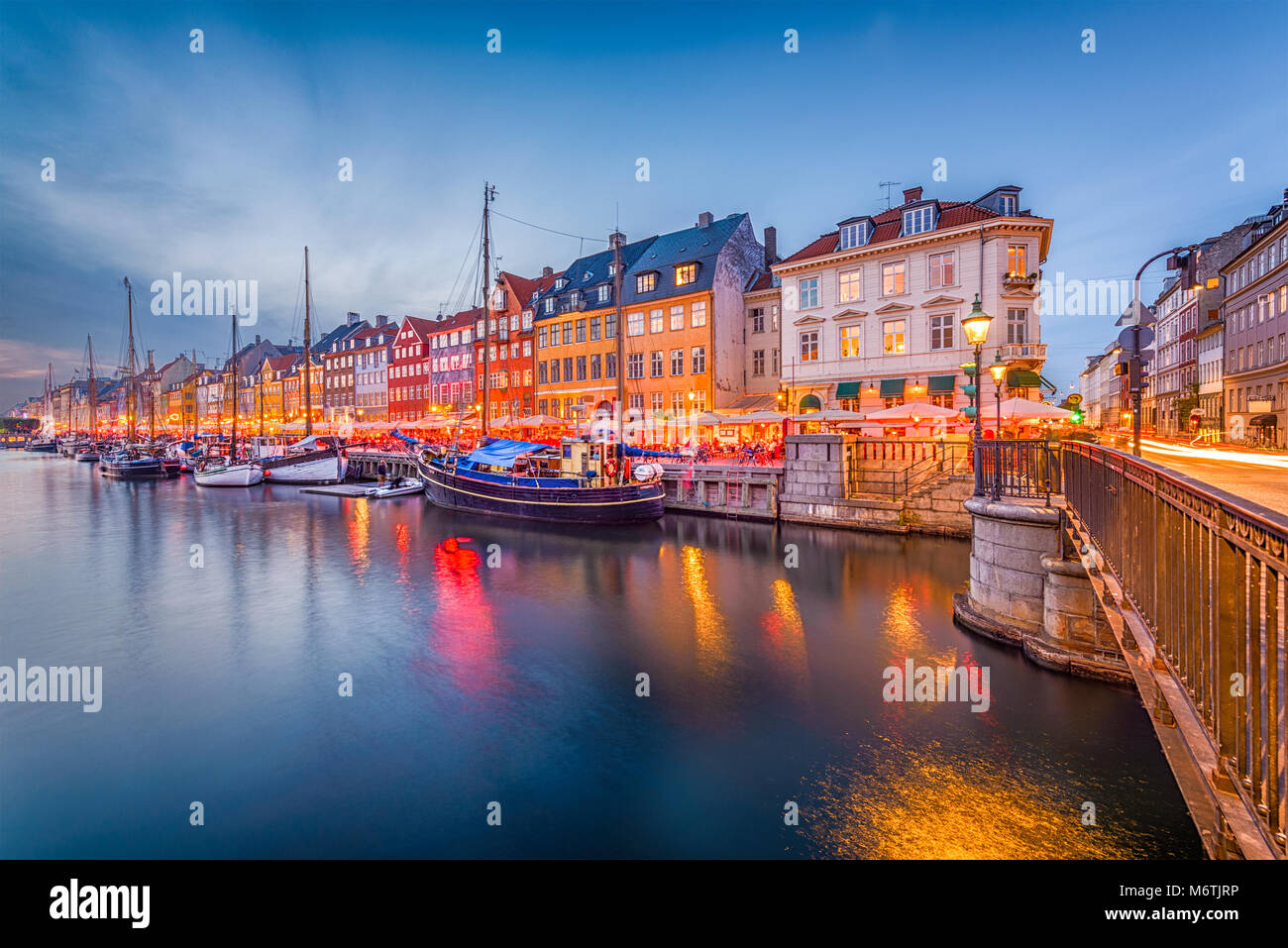 Copenhagen, Denmark skyline on the Nyhavn Canal at twilight. - Stock Image