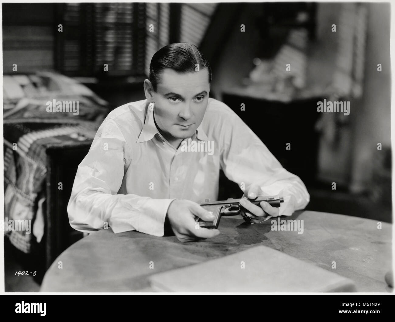 """Herbert Marshall, on-set of the Film, """"Evenings for Sale"""", Paramount Pictures, 1932 Stock Photo"""