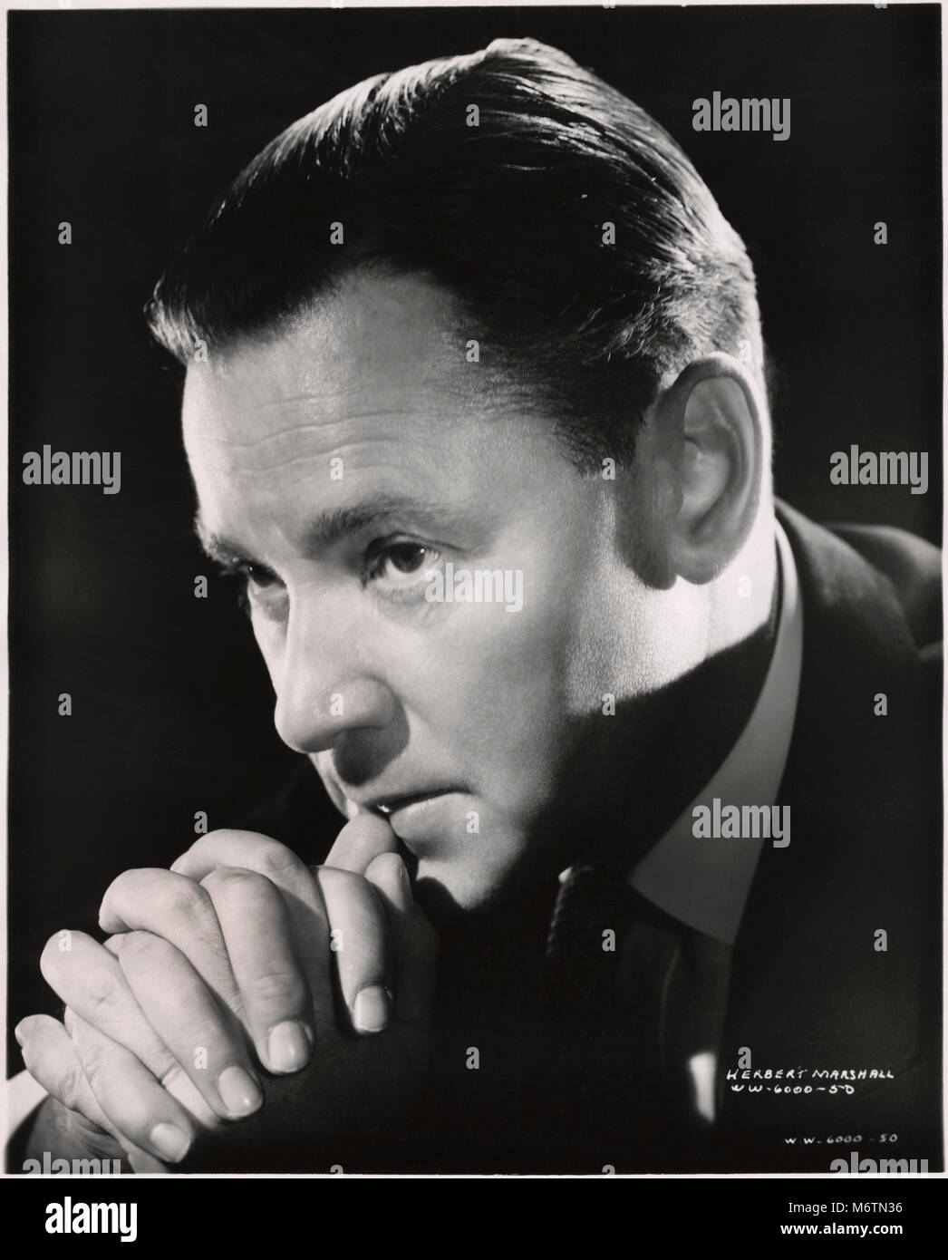 Herbert Marshall, Publicity Portrait for the Film, 'Foreign Correspondent', United Artists, 1940 - Stock Image