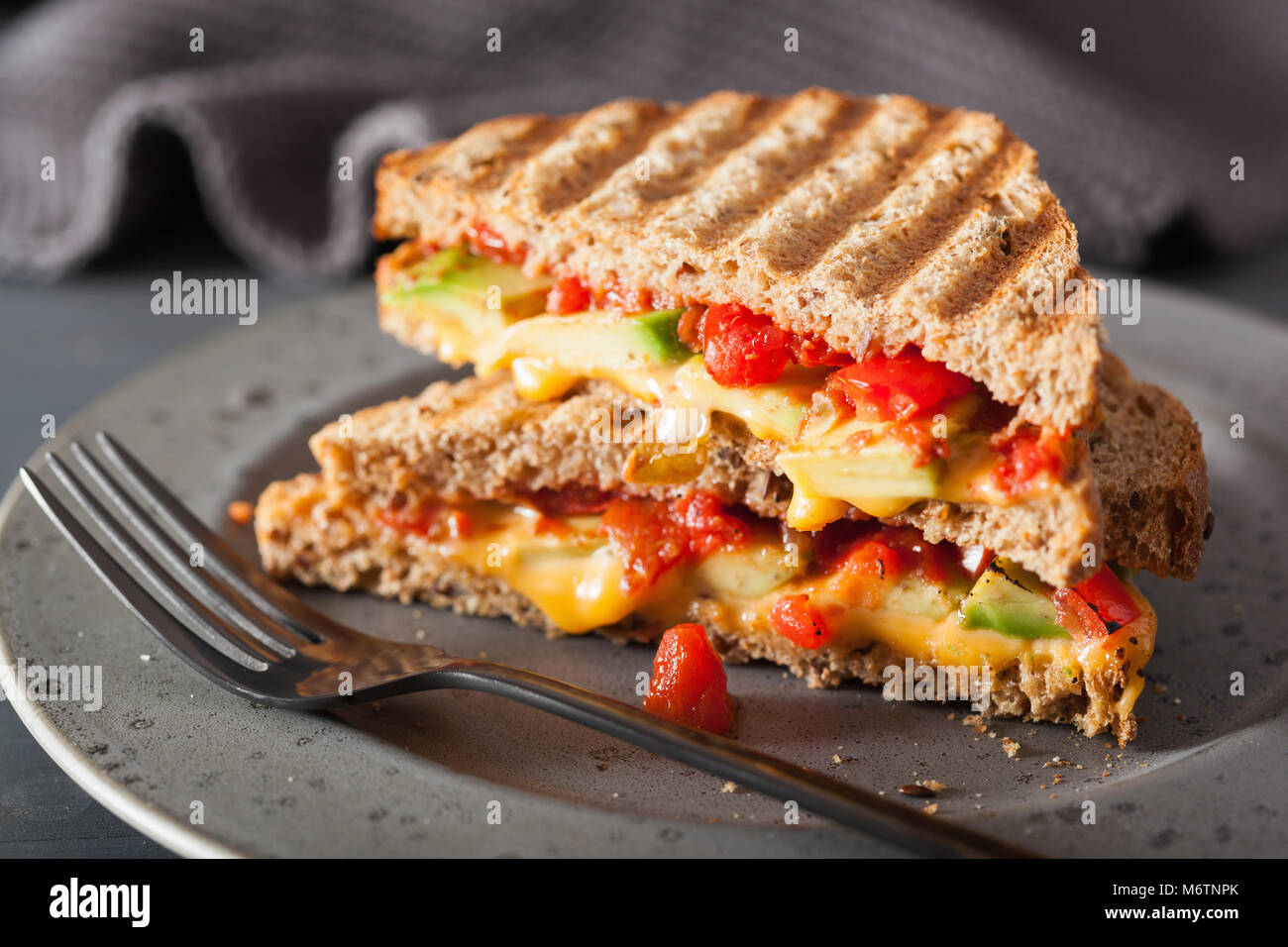 grilled cheese sandwich with avocado and tomato - Stock Image