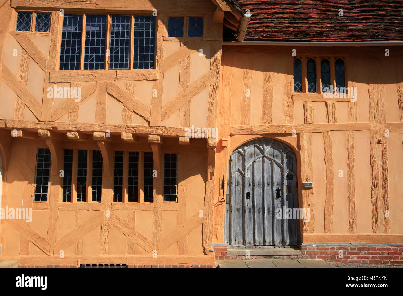 Colorful half timber framed thatched cottages, Lavenham village, Suffolk County, England, UK - Stock Image