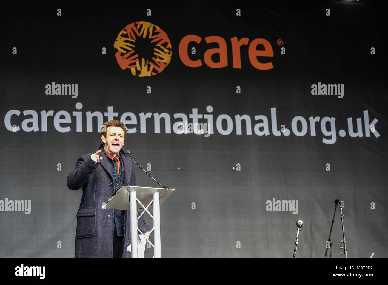 Michael Sheen reading Keir Hardie Trafalgar Square speech at the March 4 Women equality protest organised by Care - Stock Image