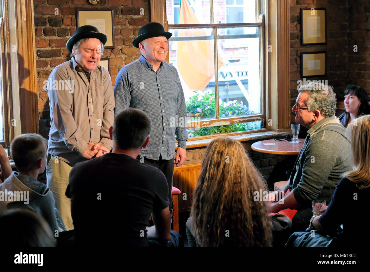 Performers / actors from The Dublin Literary Pub Crawl doing a sketch about famous Irish writers, The Duke Pub, - Stock Image