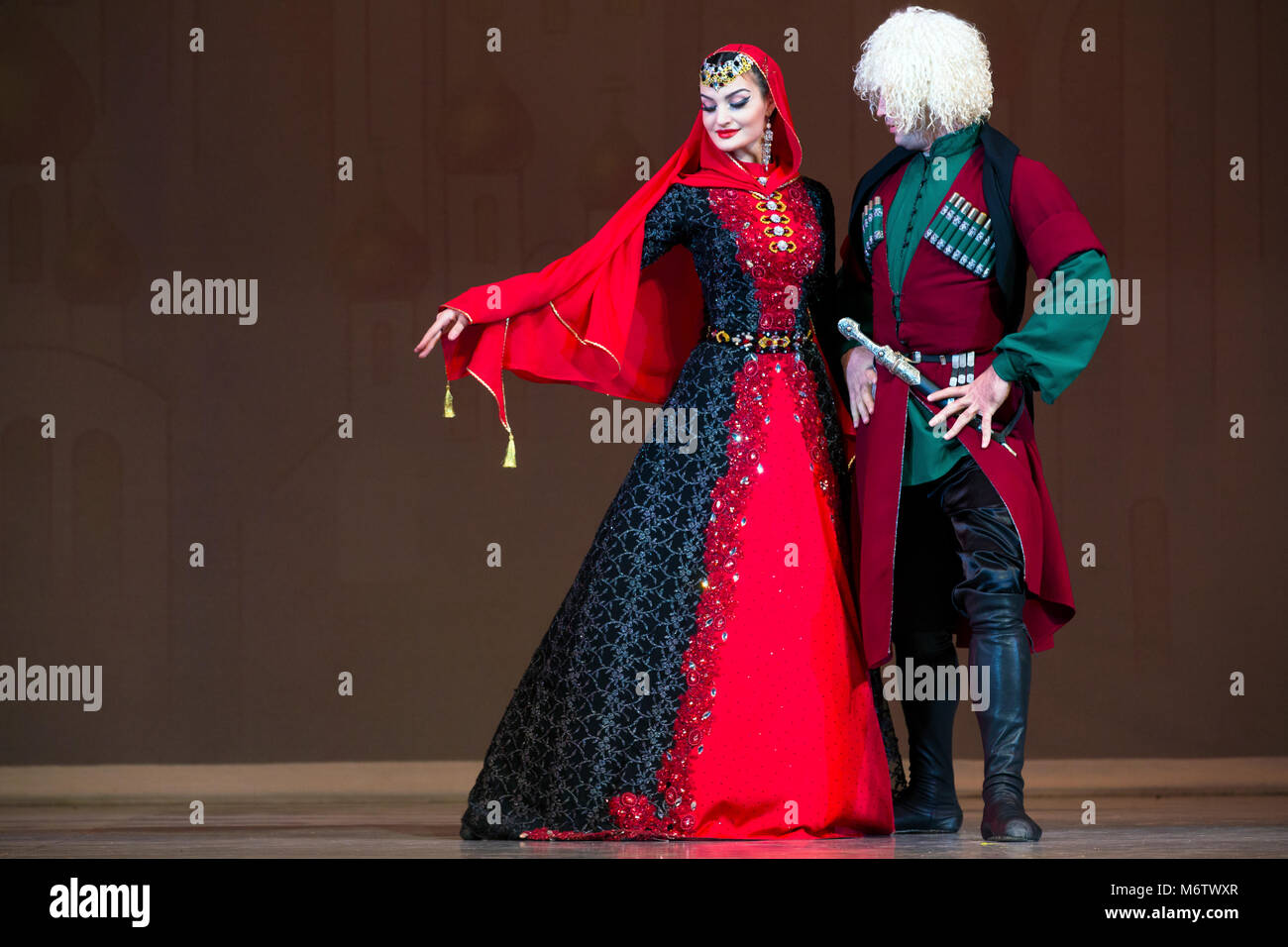 A traditional Caucasian dance performed by a couple on stage in Moscow, Russia - Stock Image
