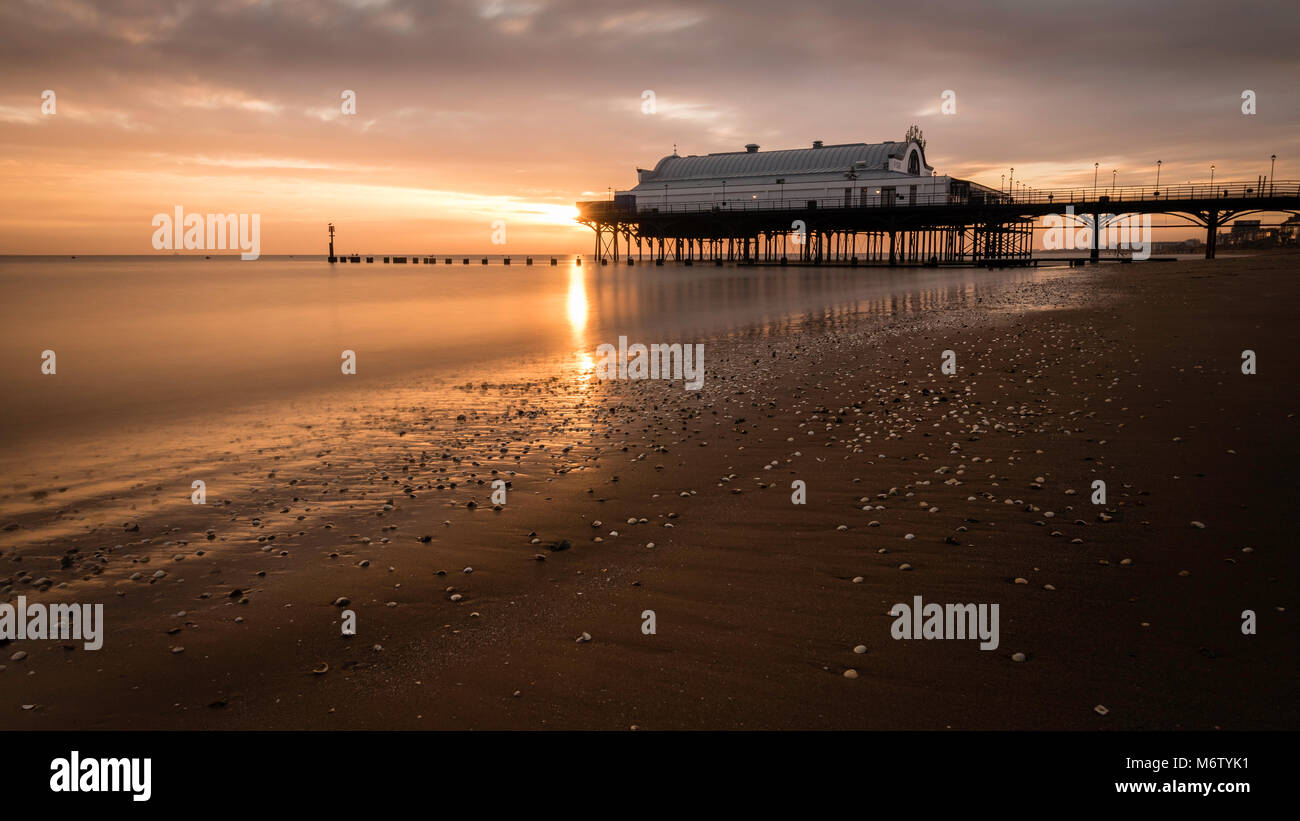 Sunrise at Cleethorpes Pier and Beach - Stock Image