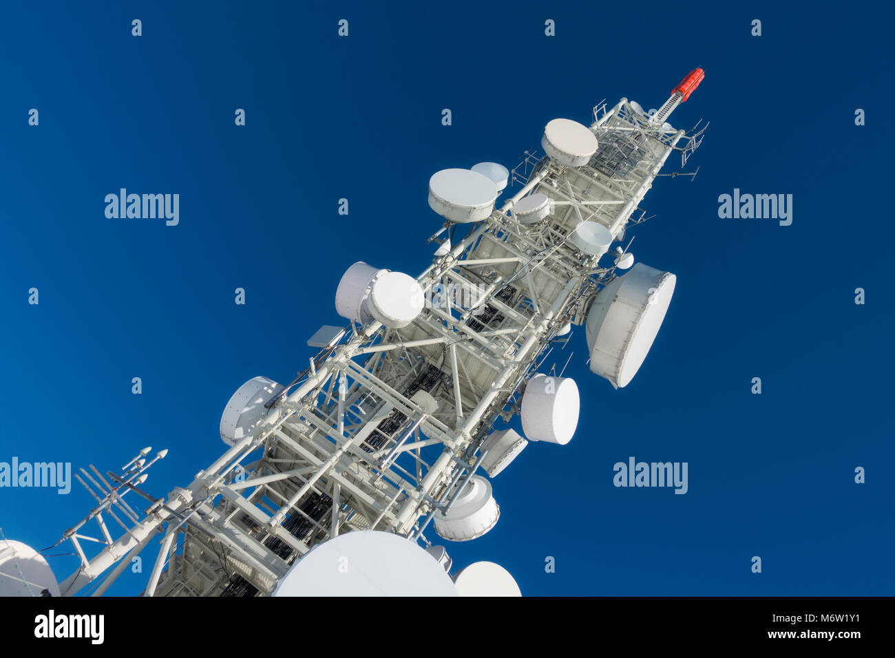Telecommunication tower with dish antennas - Stock Image