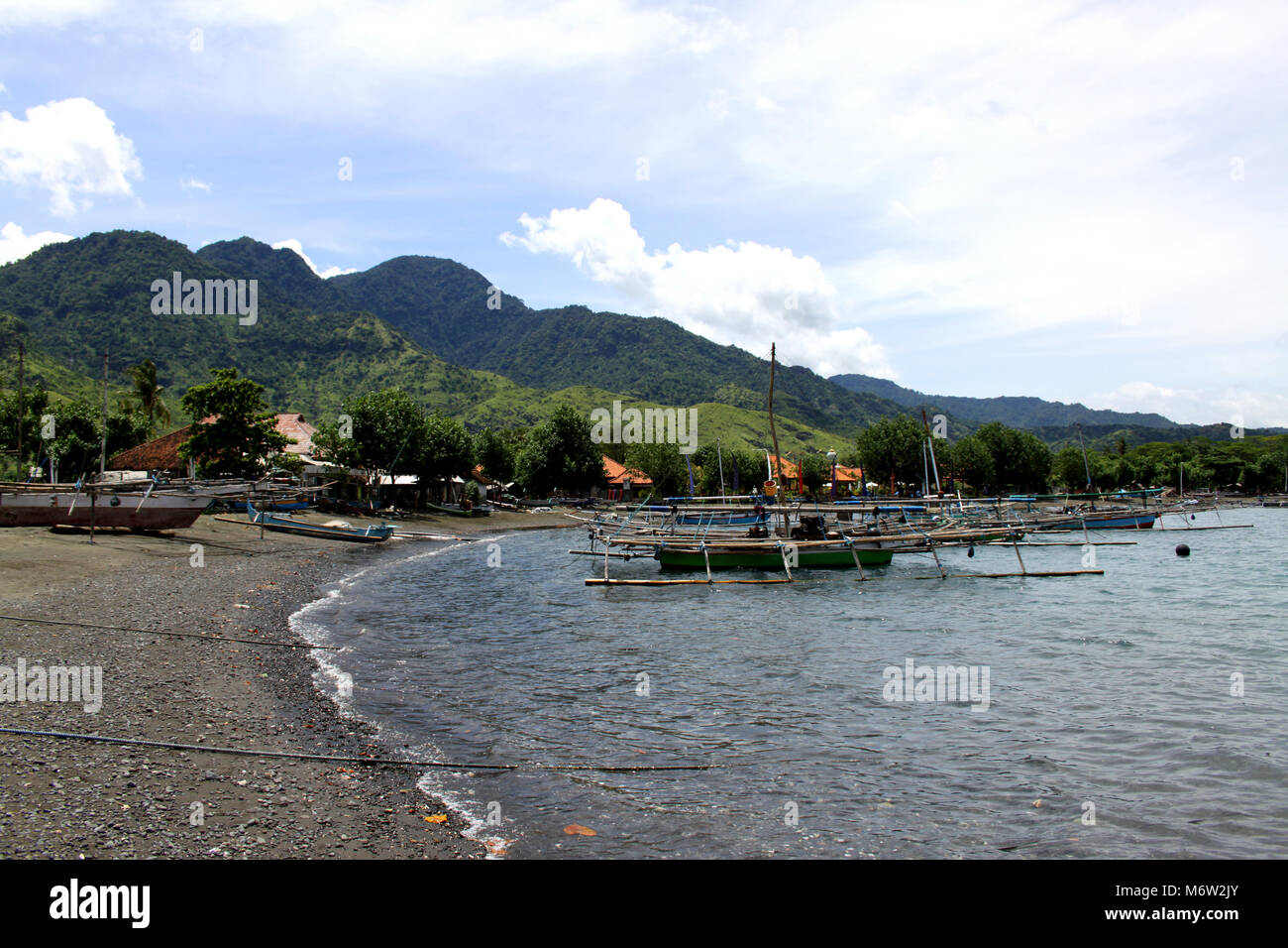 Beautiful quiet beaches in the northwest of Bali Fishing boats in the sea - Stock Image