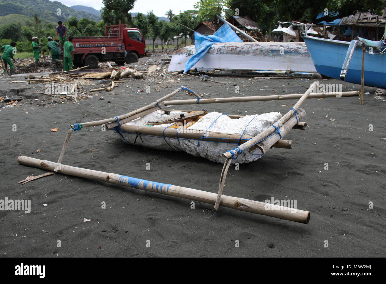 Self made fishing boat on the beach in the northwest of Bali - Stock Image