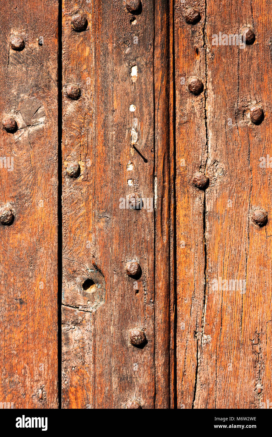 Very old, Solid wood studded doors. - Stock Image