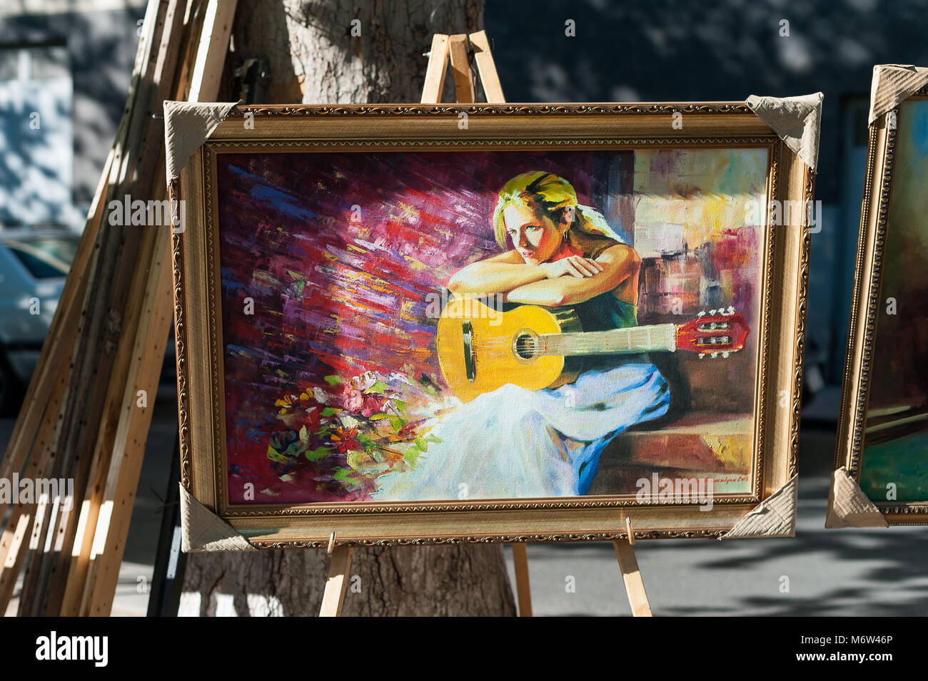 Painting of a guitar player for sale at the Yerevan open-air market,Armenia. - Stock Image