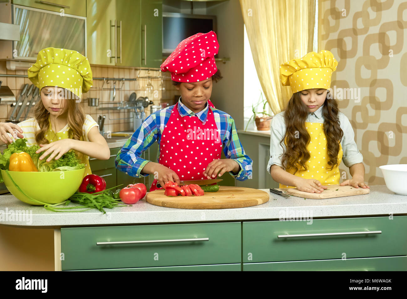 Children cooking in the kitchen. - Stock Image