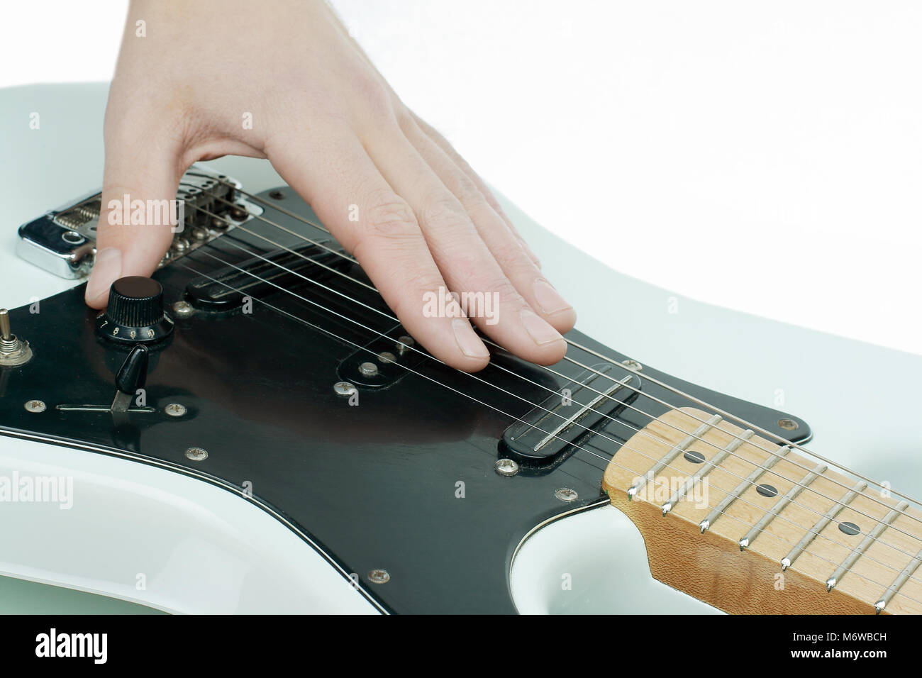 closeup.the hand of the musician stroking the strings of a guit - Stock Image
