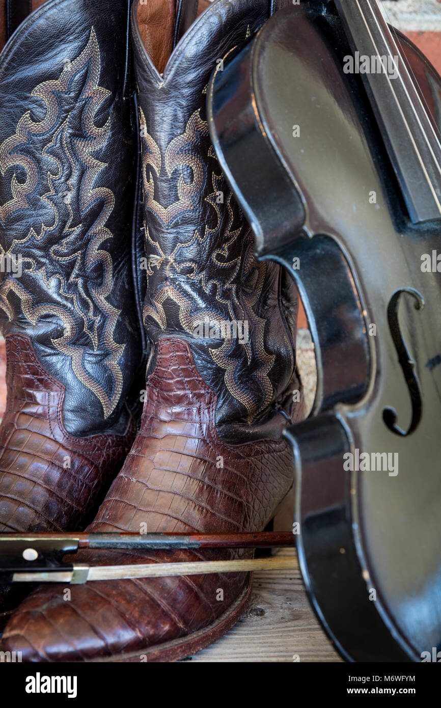 8db6924c677 Well-worn cowboy boots and fiddle, Nashville, Tennessee, USA Stock ...