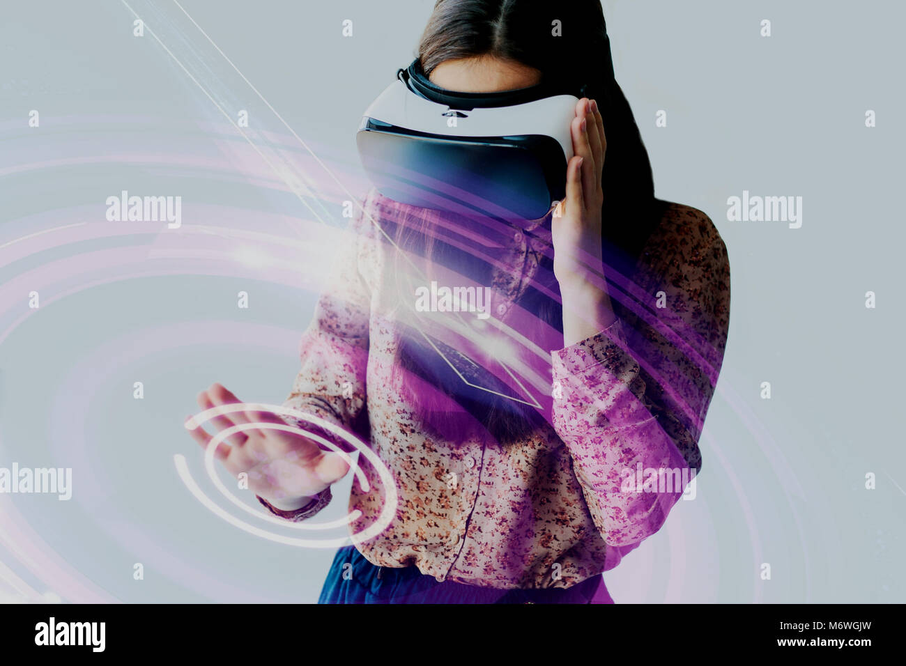The woman with glasses of virtual reality. Future technology concept. Modern imaging technology - Stock Image
