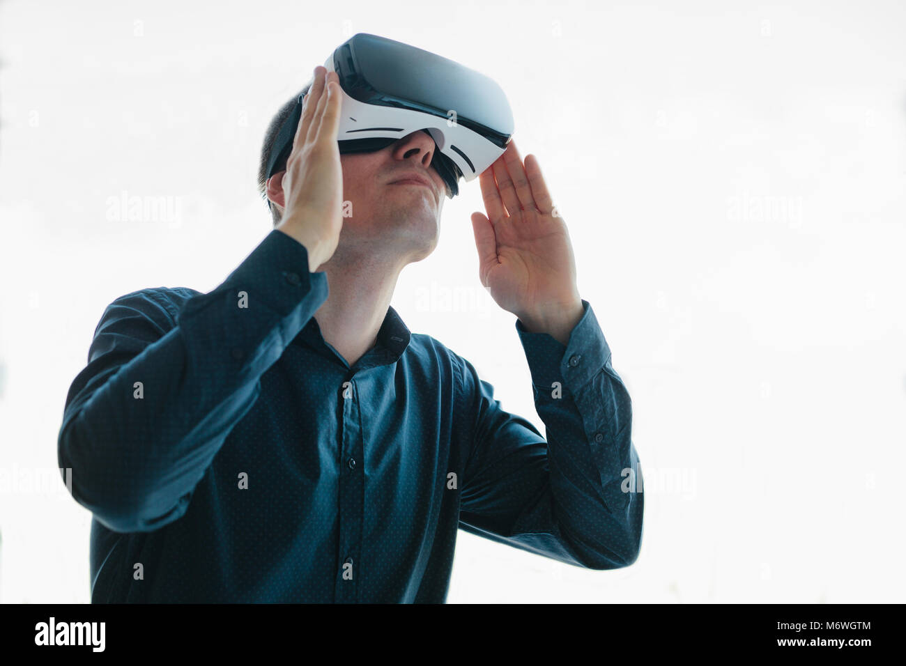 The man with glasses of virtual reality. Future technology concept. Modern imaging technology - Stock Image