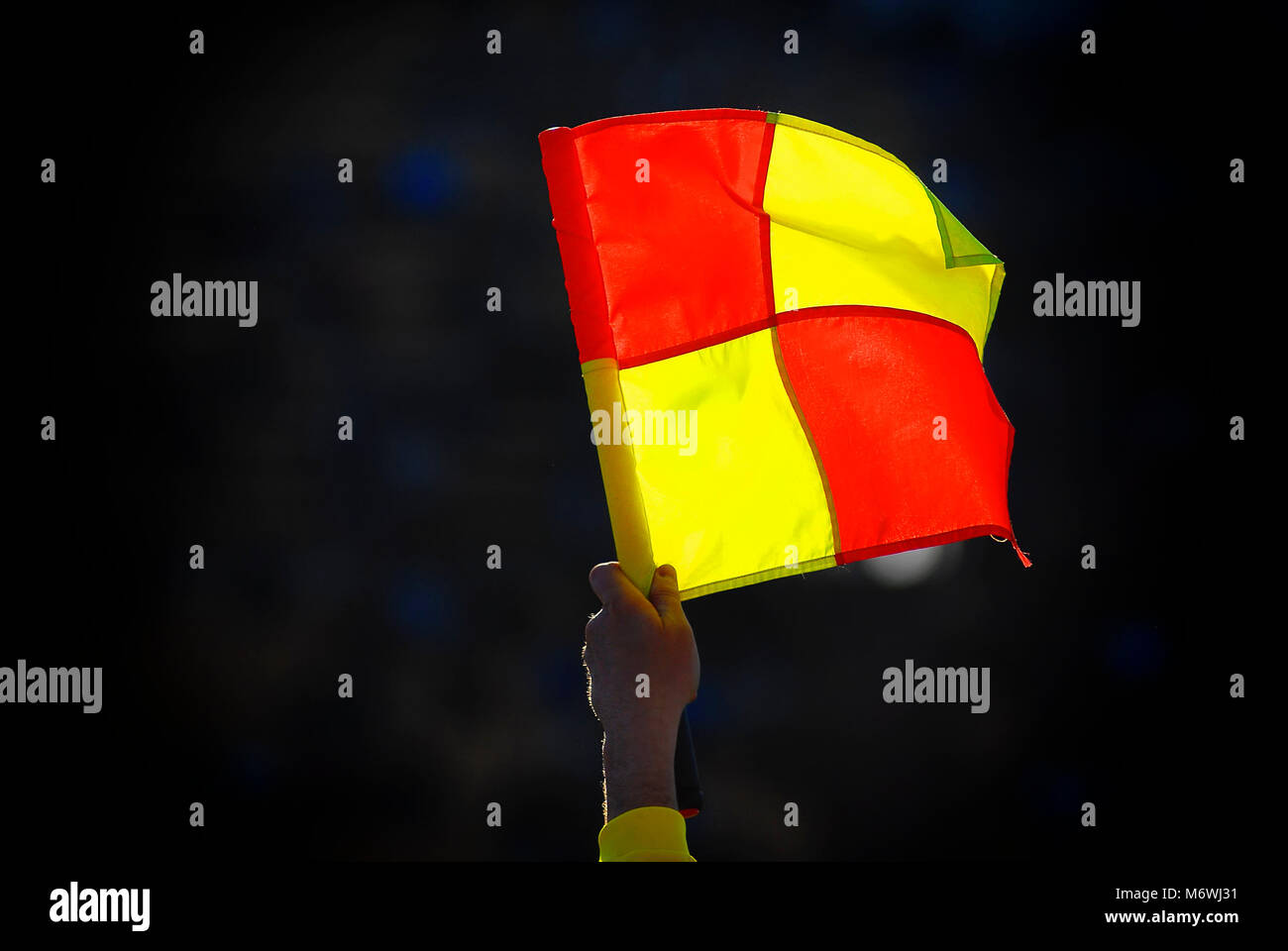 football foul flag on the background of the stands during soccer match - Stock Image