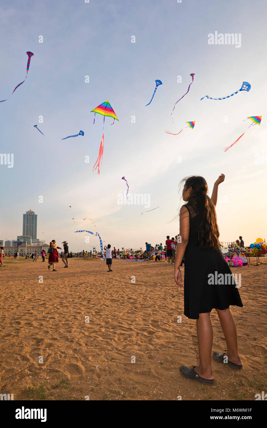 Vertical view of people kite-flying on Galle Face Green in Colombo, Sri Lanka. Stock Photo