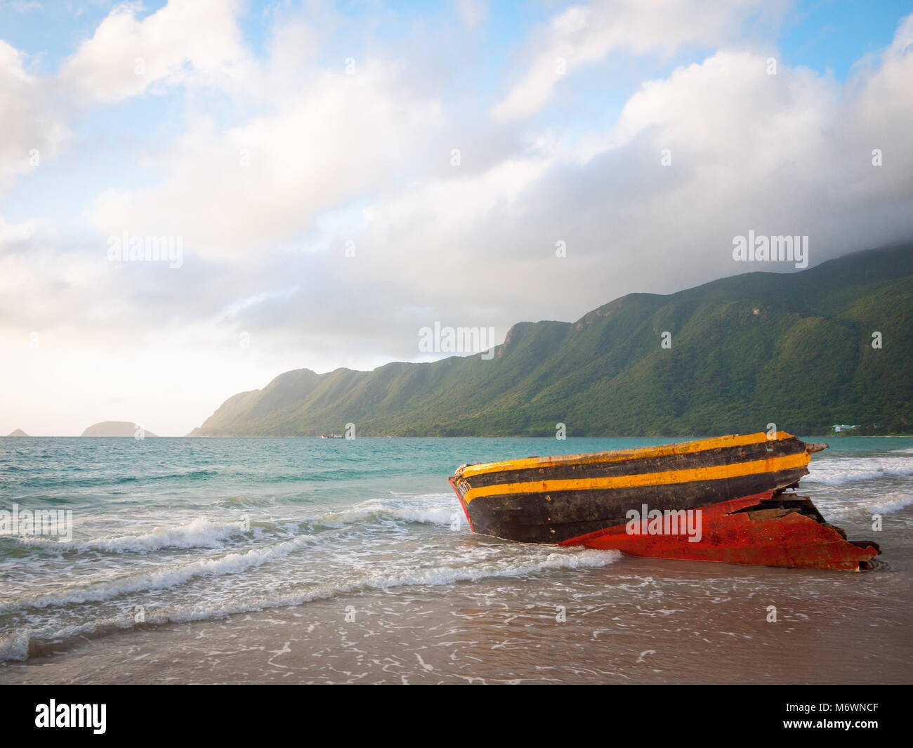 A shipwreck washed ashore Bai An Hai Beach on Con Son Island, Con Dao Islands (Con Dao Archipelago), Vietnam. - Stock Image