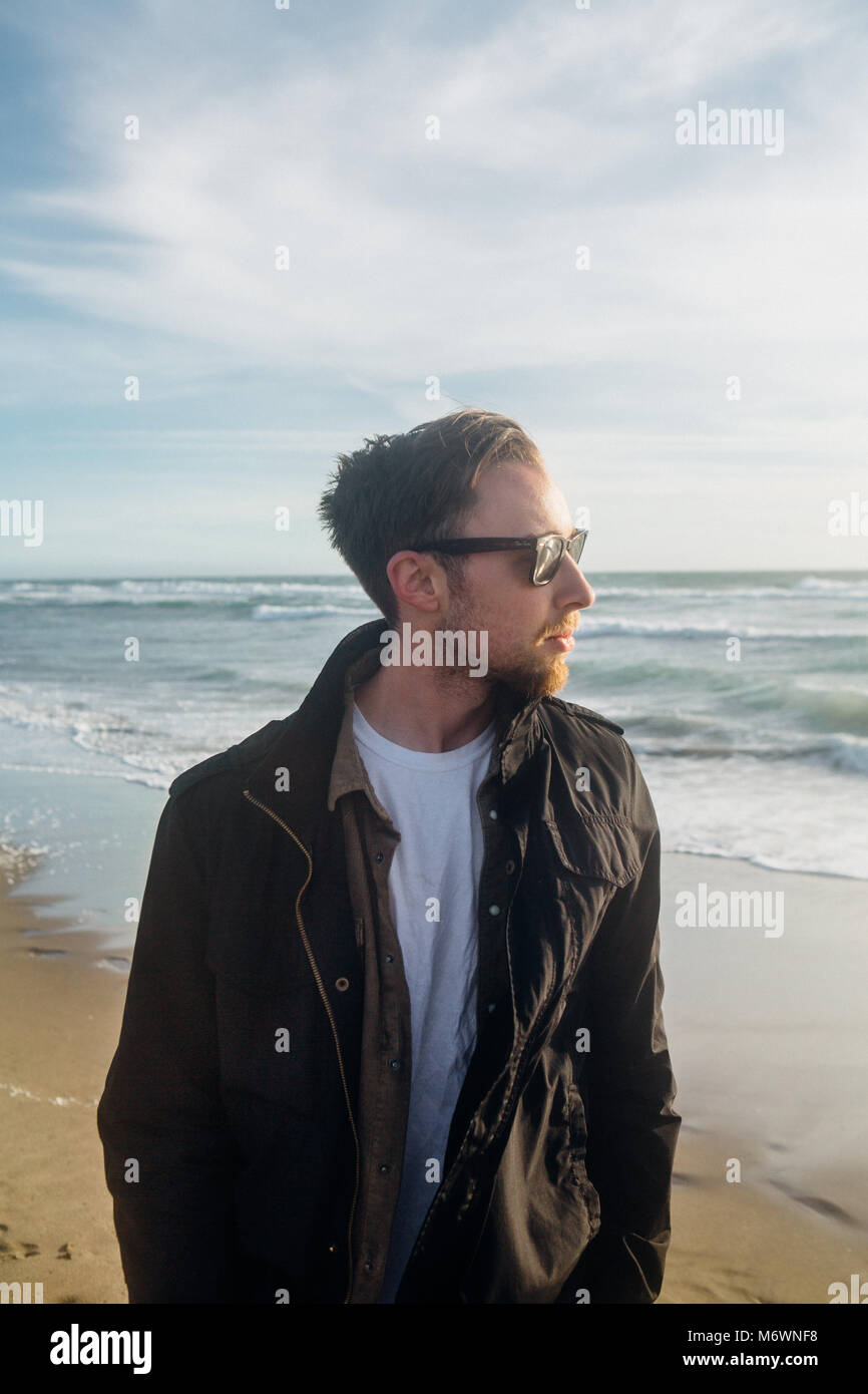 Young Millennial on the Beach - Stock Image