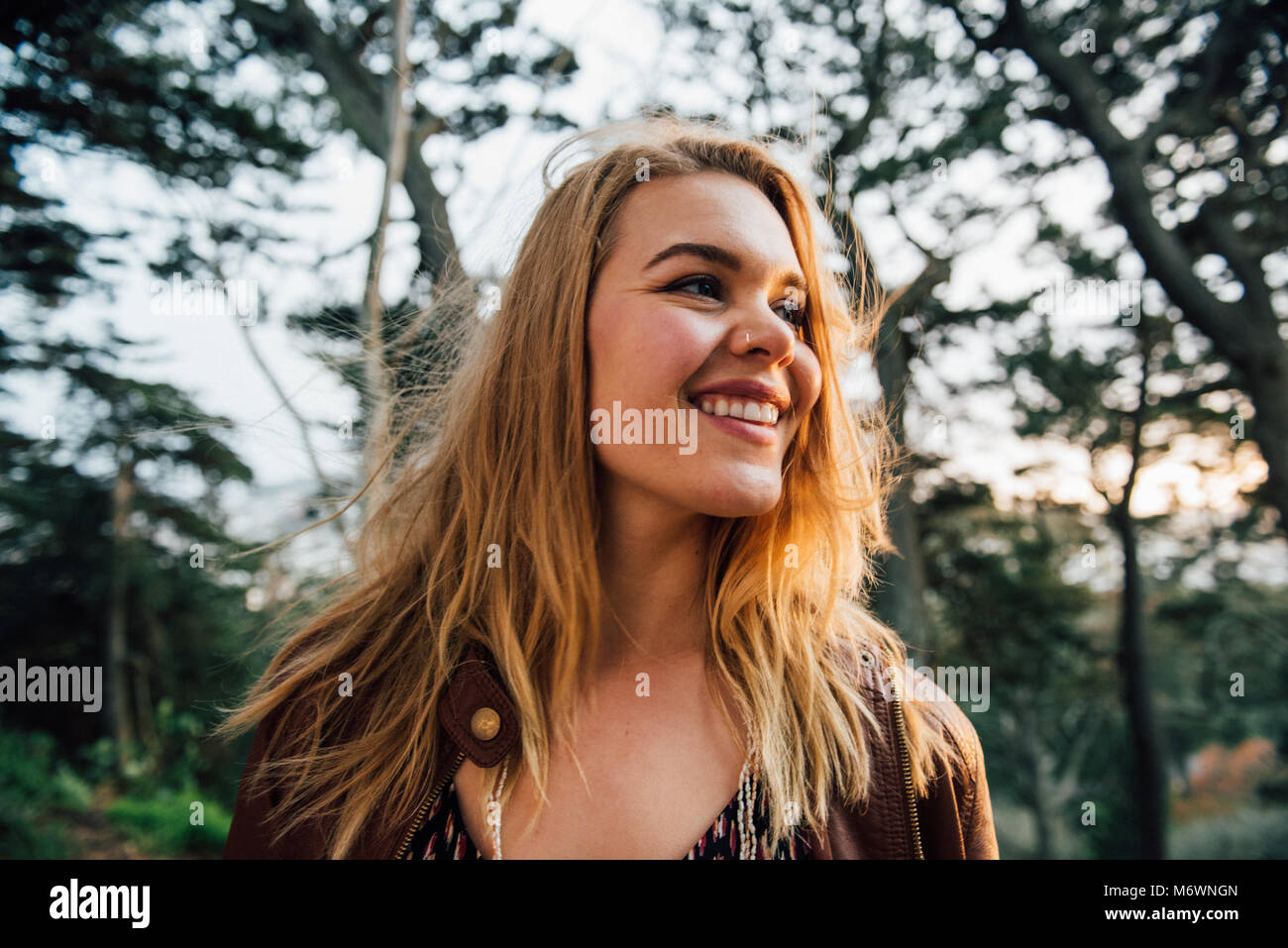 Young woman explore Golden Gate Park at sunset. - Stock Image