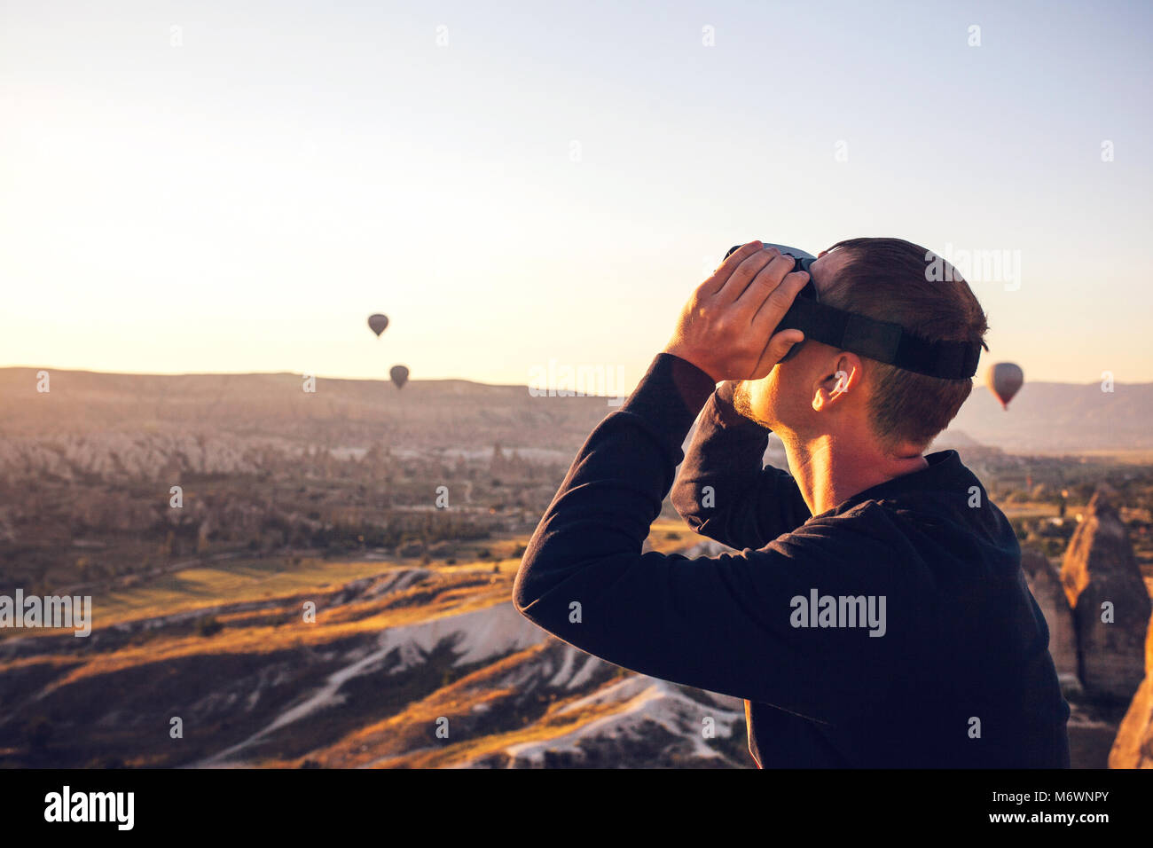 The man with glasses of virtual reality. Future technology concept. Modern imaging technology. - Stock Image