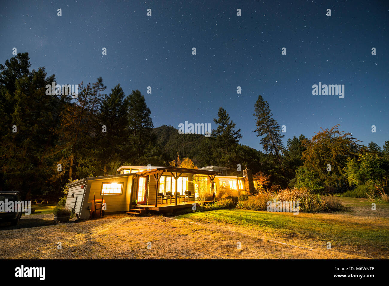 The Otter Bar Lodge and Kayak School is illuminated at night under a