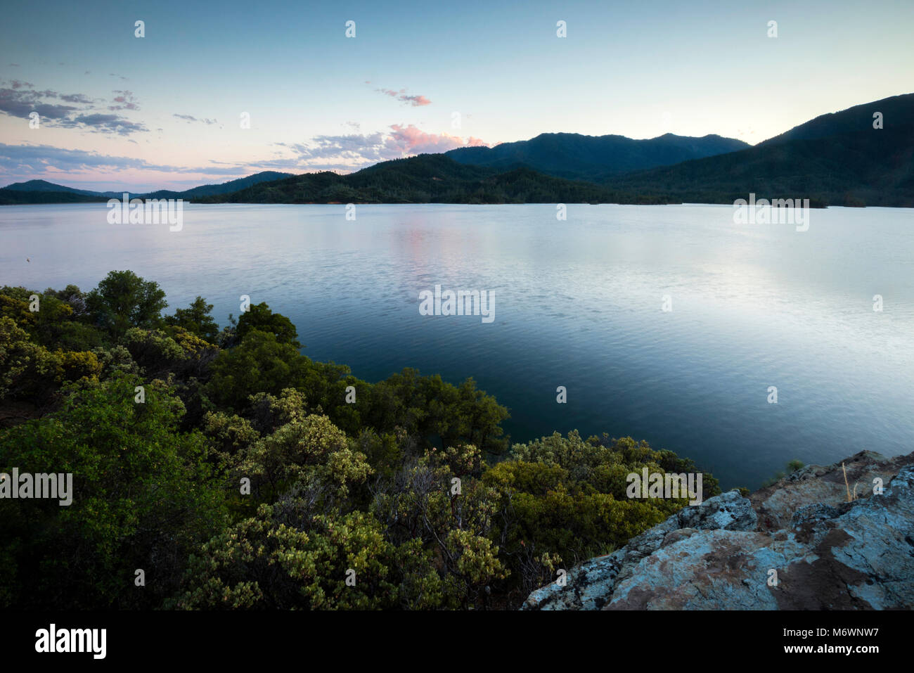 A beautiful view at dusk looking out over Whiskeytown Lake near Redding, California. - Stock Image