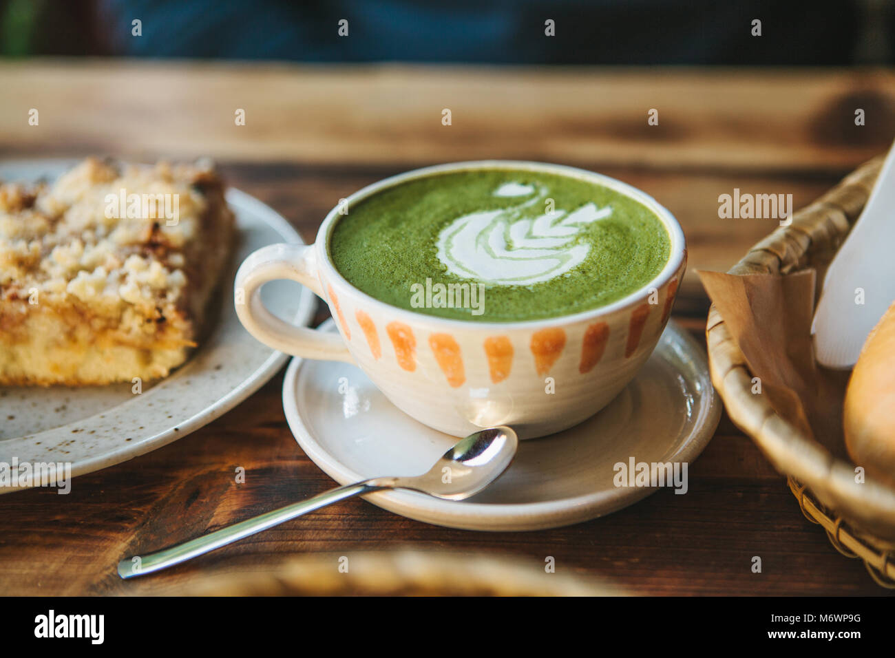 Close-up ceramic cup with green tea called Matcha - Stock Image