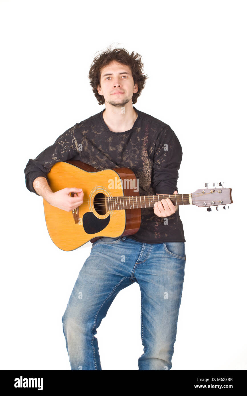 Young man wearing in black shirt and jeans playing on a gitare - Stock Image