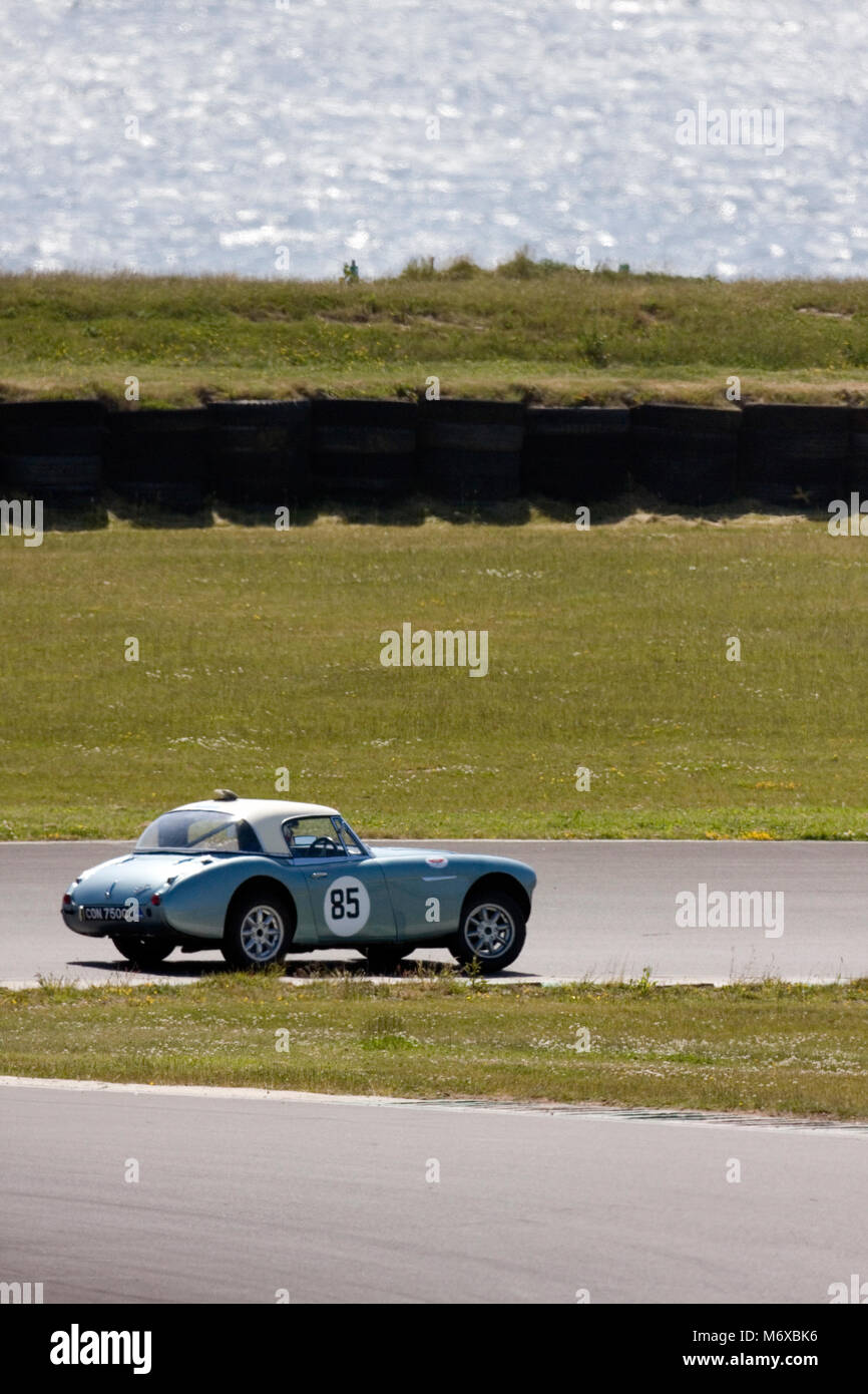 Classic sports car speeding around the Anglesey motor racing circuit, Ty Croes, Anglesey, Wales, June - Stock Image