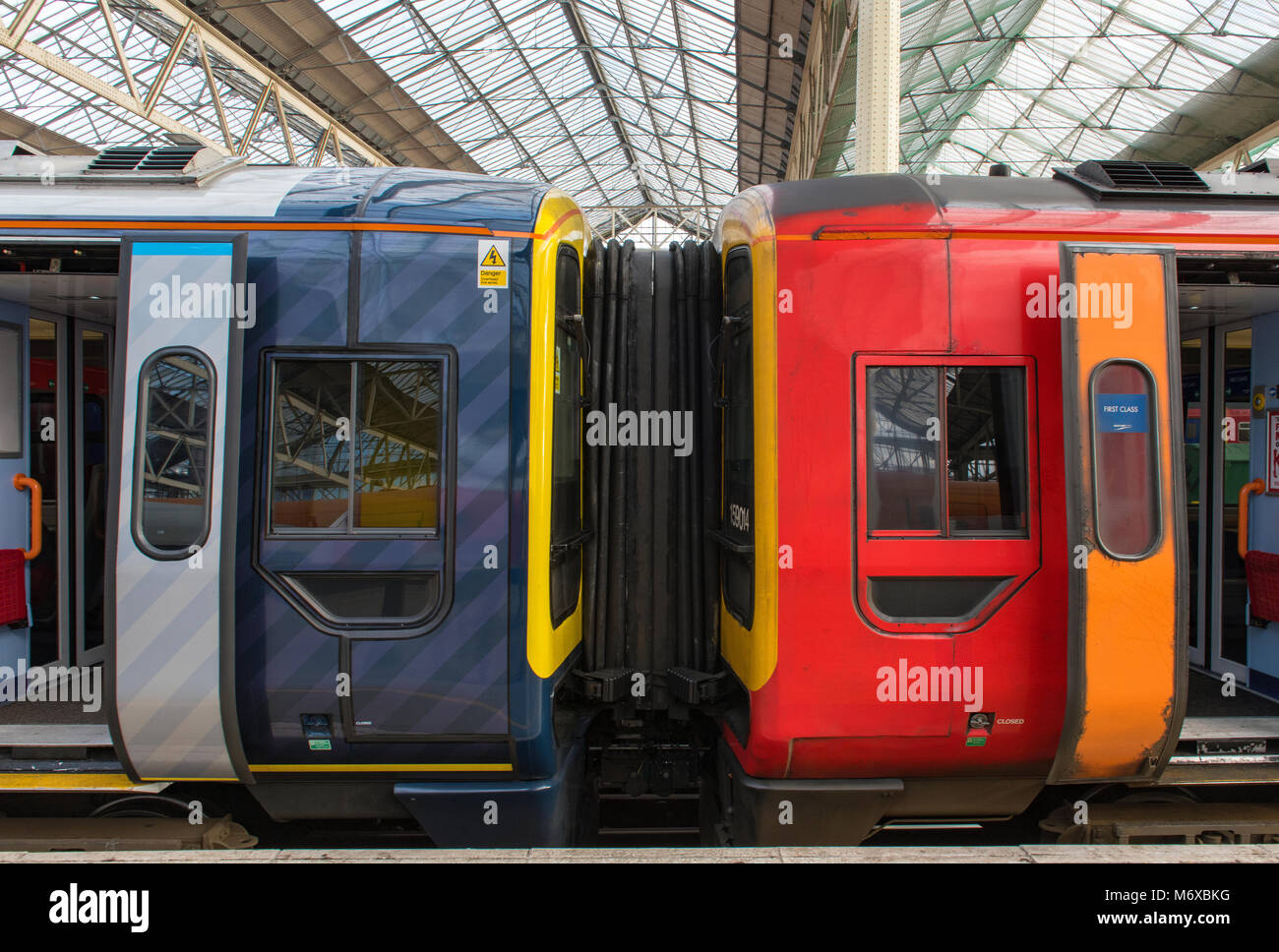 Train operating companies rolling stock in the plate form at london waterloo station during the changing of the - Stock Image