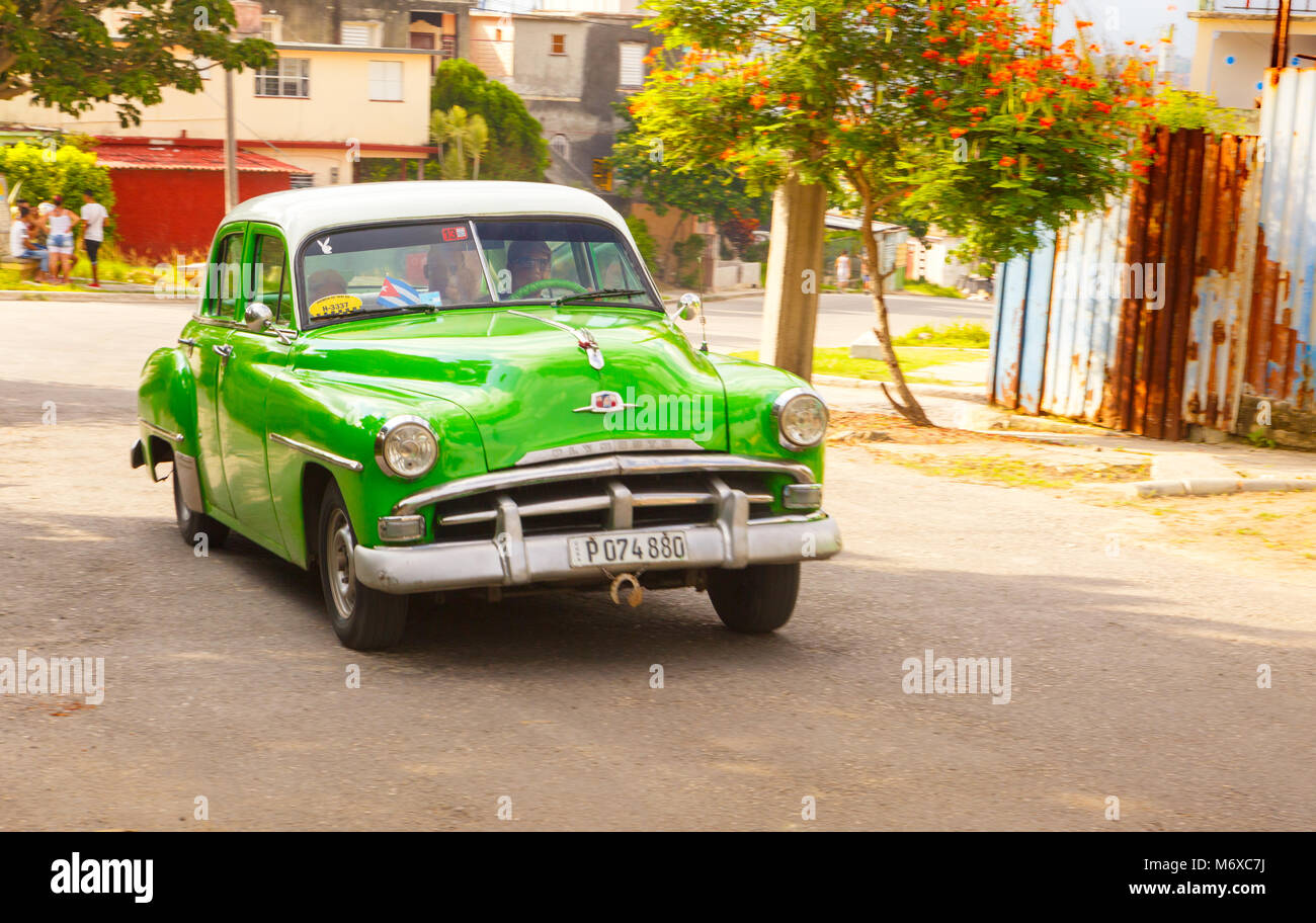 Vintage Car Moving Forward in a Small Province in Cuba - Stock Image