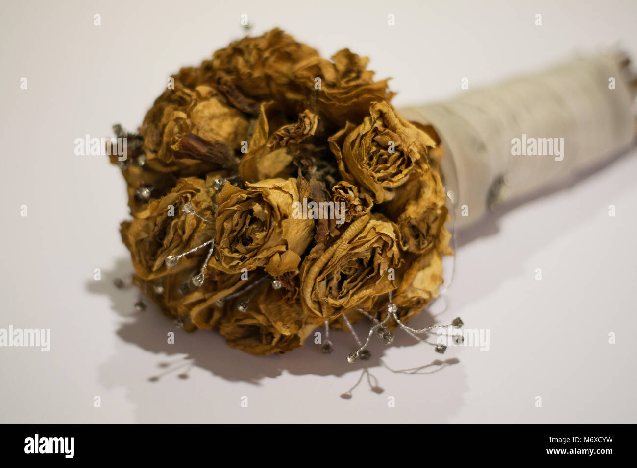 Bouquet of dead roses used in wedding - Stock Image