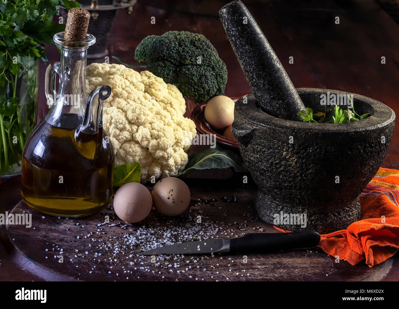 Fresh Raw Vegetables on a wooden board with a mortal and pestle. Closeup. Studio Photography. - Stock Image