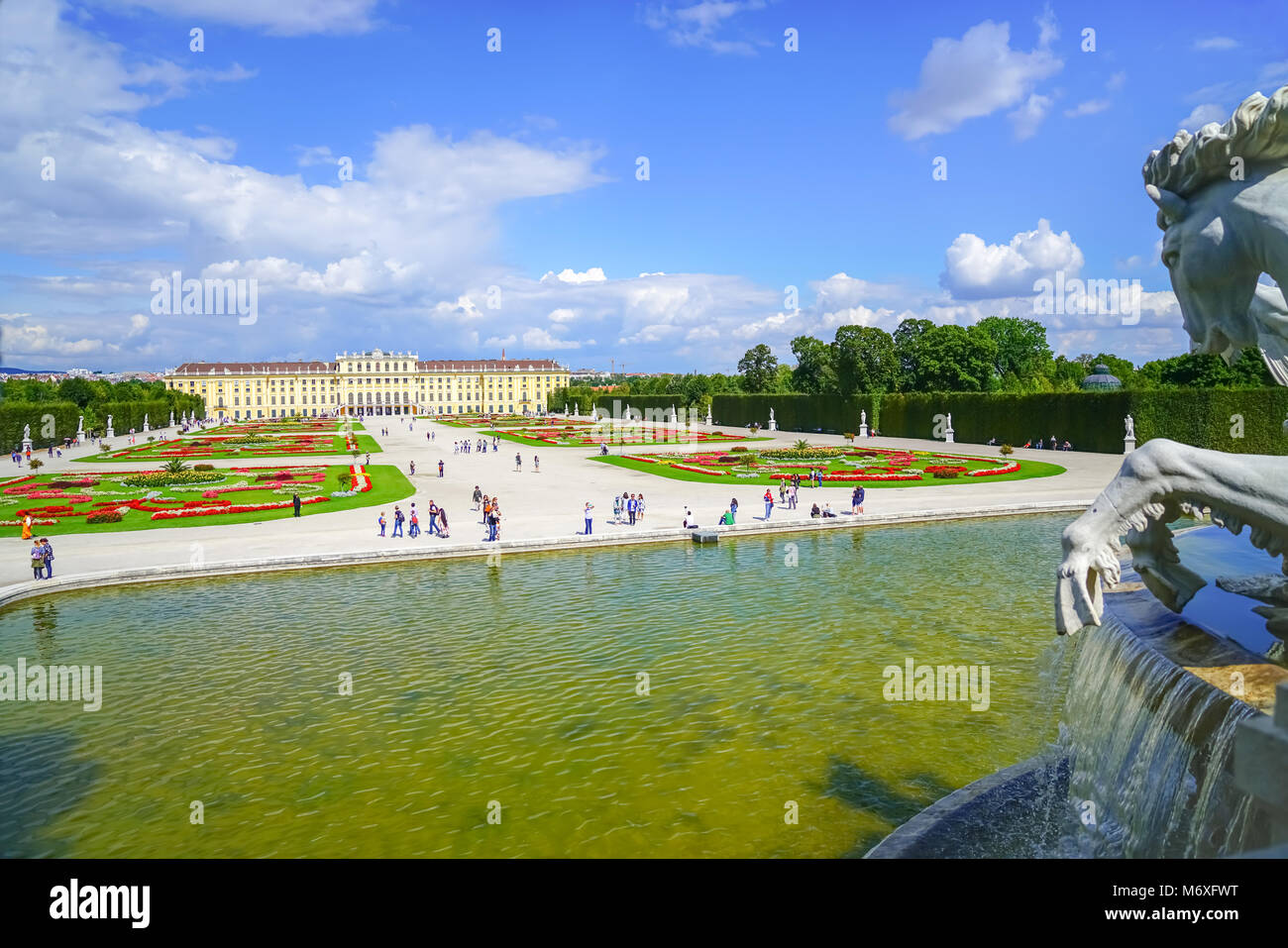 VIENNA,AUSTRIA - SEPTEMBER 4 2017; Tourists in grounds beyond large pond and horse statue of Baroque architectural - Stock Image