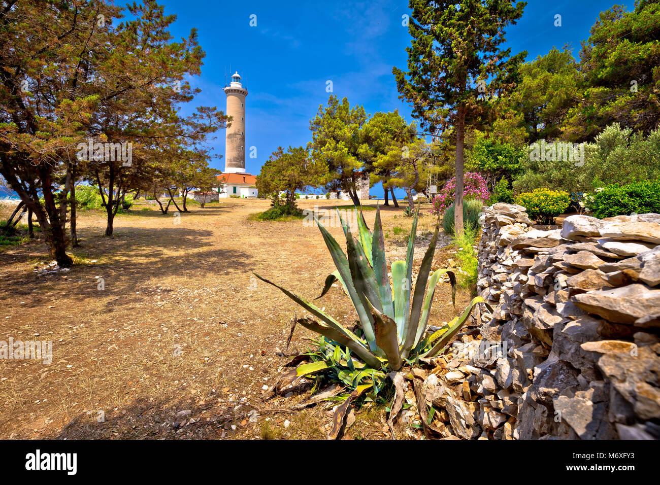 Veli Rat lighthouse in green Mediterranean landscape, Dugi Otok island, Dalmatia, Croatia - Stock Image