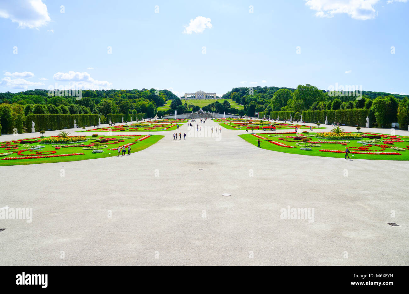 VIENNA,AUSTRIA - SEPTEMBER 4 2017; Tourists  between gardens on long path leading to Gloriette in landscaped grounds - Stock Image