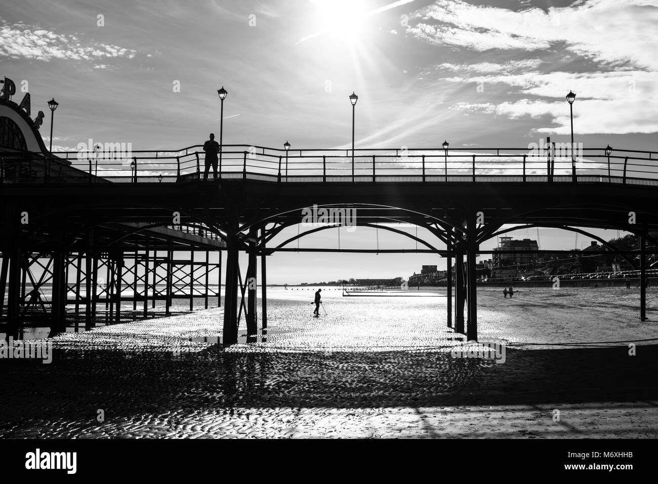 Cleethorpes pier silhouetted at sunrise in winter. Cleethorpes, North East Lincolnshire, England, UK - Stock Image