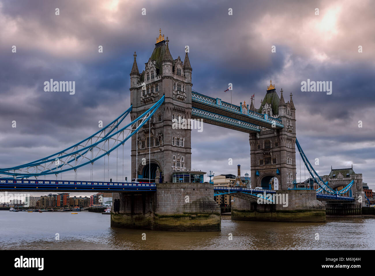 Famous Tower Bridge under cloudy sky in London, UK. - Stock Image
