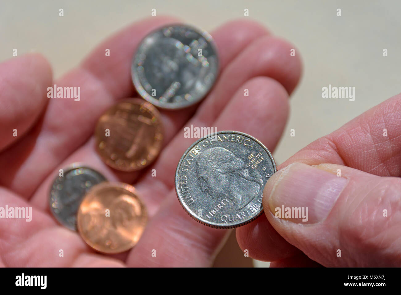 Detail shows counting United States coins or change. Or giving US change for in-store purchase. Could also illustrate - Stock Image