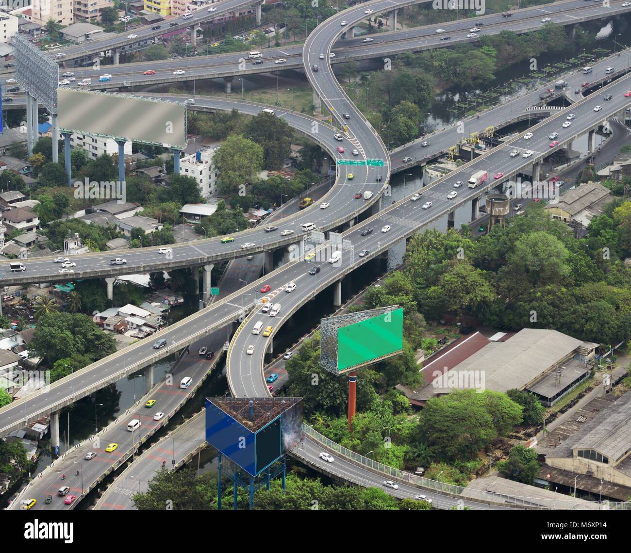 Asian city with overpasses and viaducts, view from the heights - Stock Image