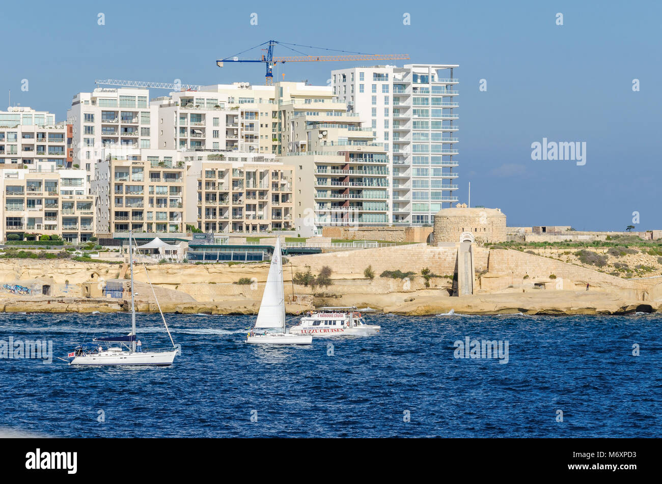 Valletta, Malta - November 8, 2015: Construction of modern buildings close to old fortifications of Order of Saint - Stock Image