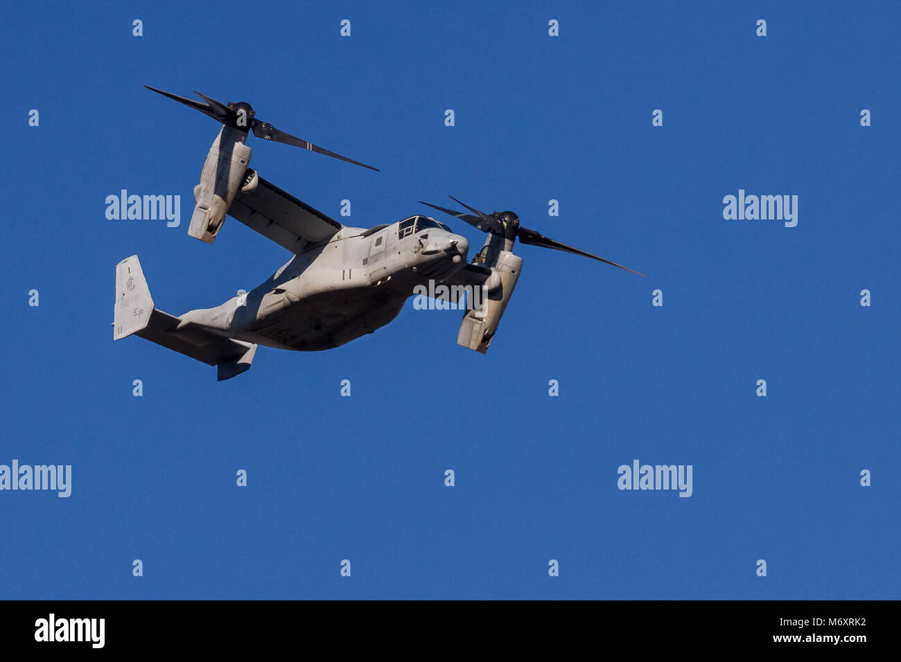 Bell Boeing V-22 Osprey tilt-rotor aircraft, operated by the US Marine Corps, flying over Chuo Rinkan in Kanagawa, - Stock Image