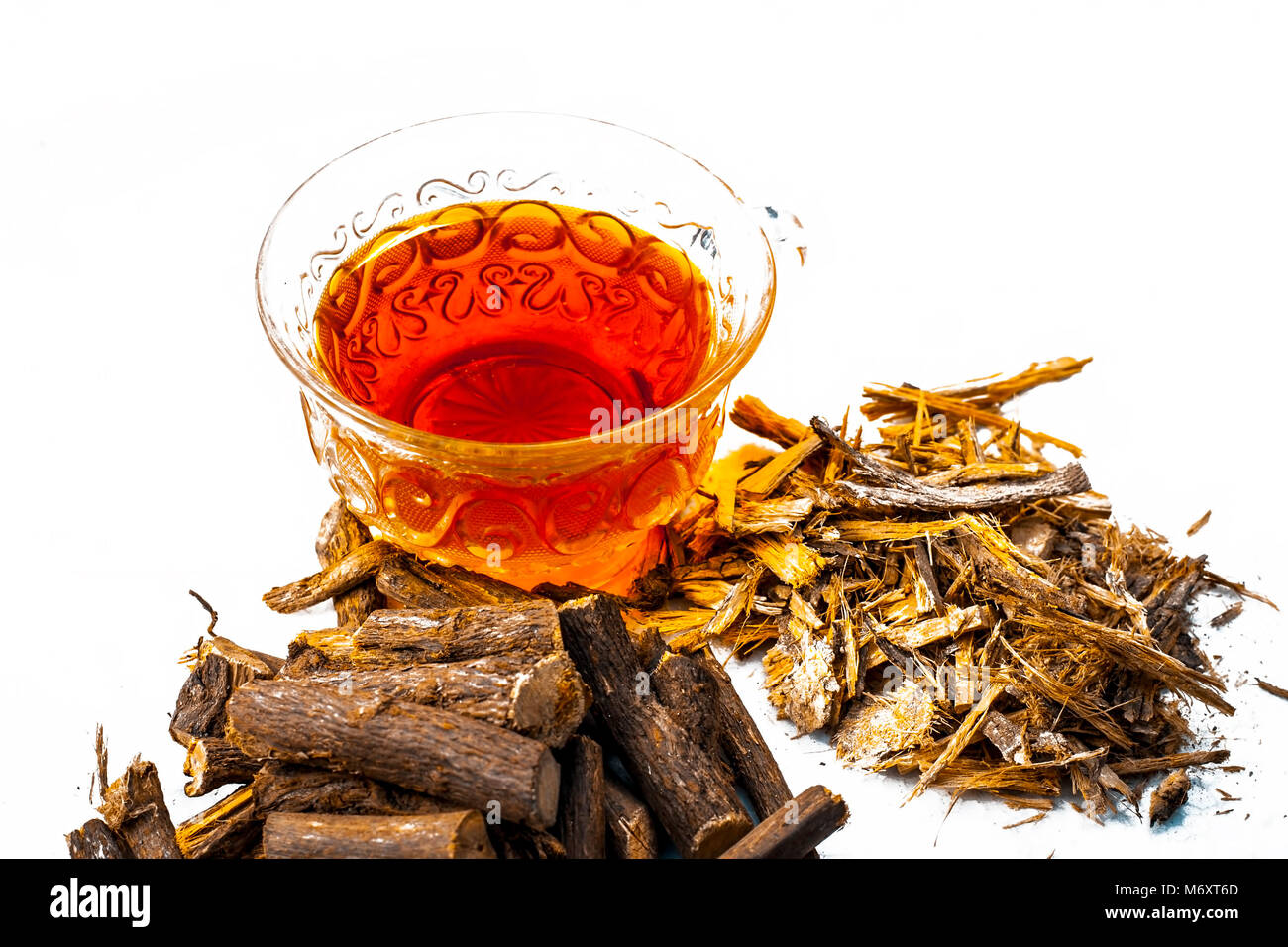 Ayurvedic herb Liquorice root,Licorice root, Mulethi or Glycyrrhiza glabra root and its powder with its tea for Stock Photo