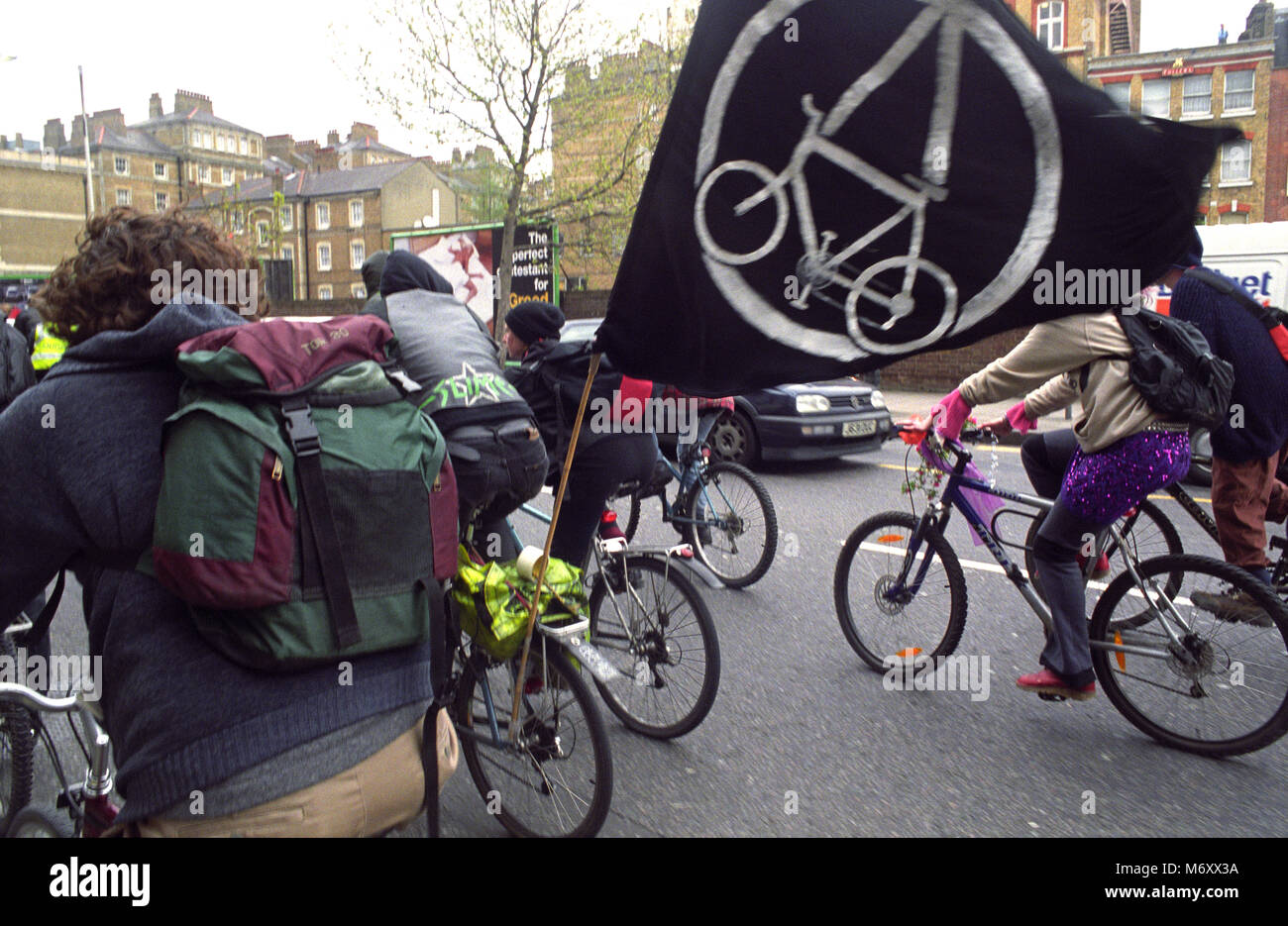 Critical Mass cyclists ride during May Day demonstrations in London 1st May 2001 - Stock Image